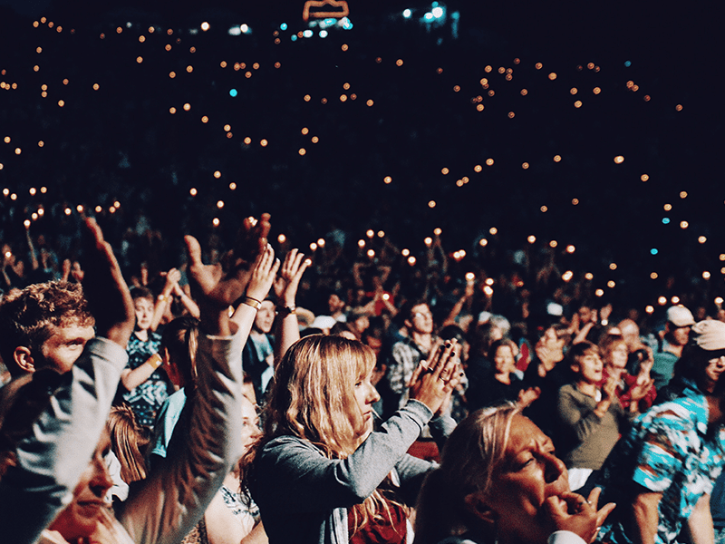 Building a following, like this crowd cheering, is a part of social media and crowdfunding.