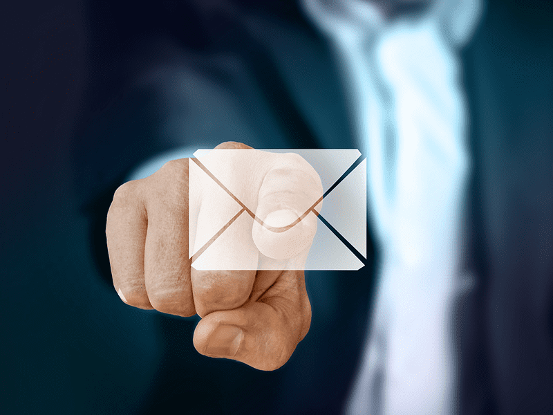 How to Market Your Crowdfunding Campaign: A businessman pressing an email symbol.