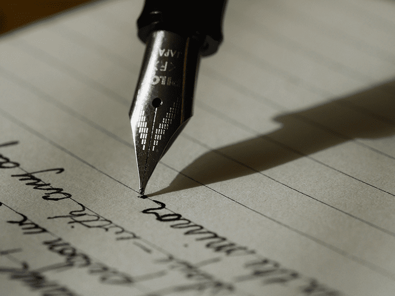 A good crowdfunding video script could start with a pen and paper as shown here.