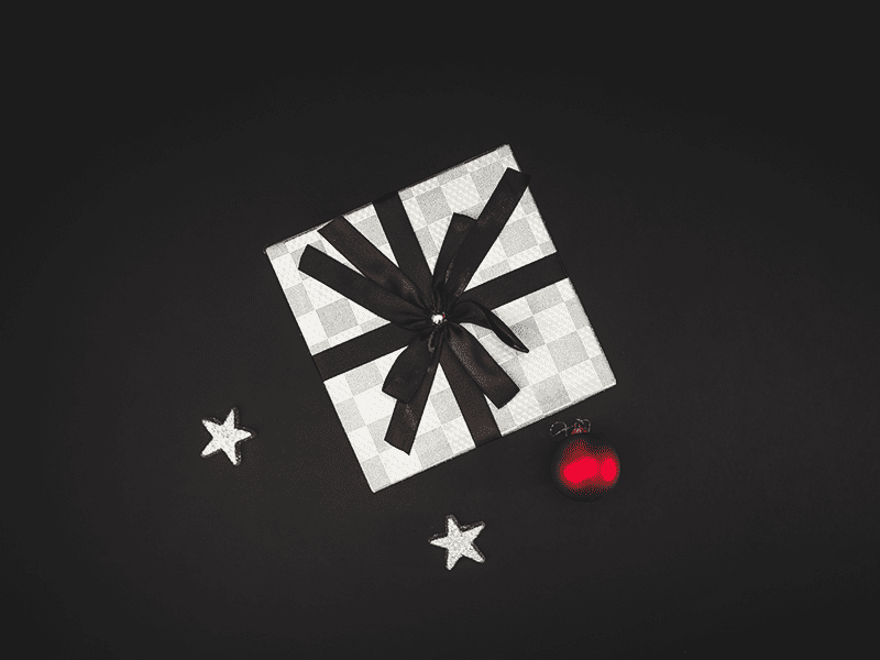 How does crowdfunding work? A present on a black backdrop.